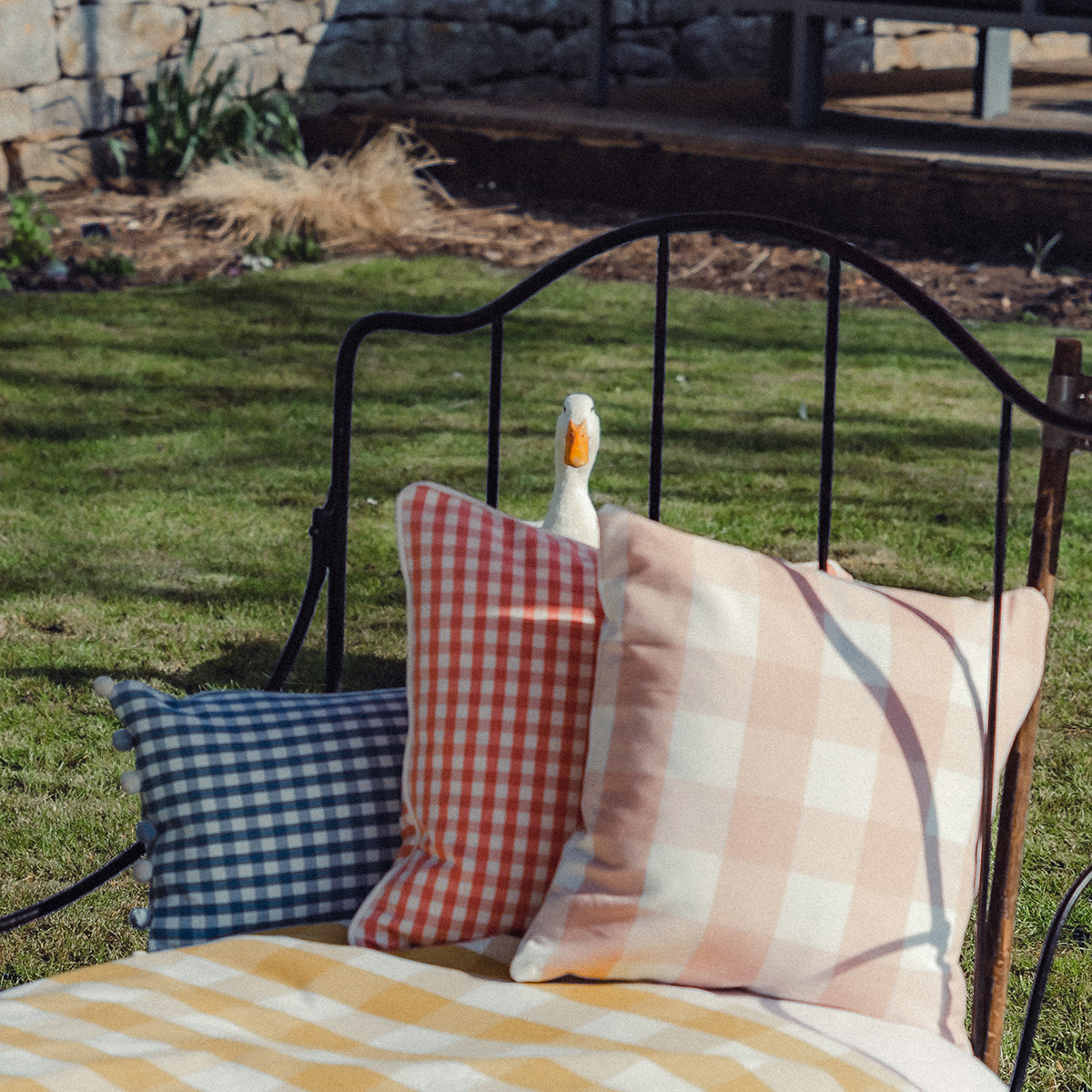 Studio Blackwell Rectangle Pom Pom Cushion with resident duck